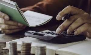 Man calculating cost and savings.